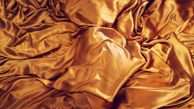 Golden silk background. Satin fabric backdrop Stock Photo