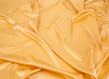 Golden silk drapery. Stock Images
