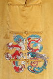 Golden silk dress. Chinese golden yellow silk Gua Royalty Free Stock Image