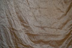 Golden silk fabric Royalty Free Stock Photos