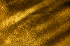 Golden silk fabric Stock Images