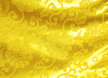 Golden silk with flower pattern Stock Images