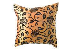 Golden silk pillow with black ornaments. On white background for designers Royalty Free Stock Photo