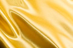 Golden silk Stock Images