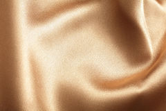 Golden silk texture Royalty Free Stock Images