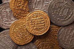 Golden and silver ancient arabic coins closeup Royalty Free Stock Image