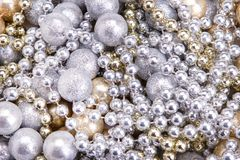 Background of gold and silver beads. Golden silver beads close-up. royalty free stock photos