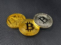 Golden and silver bitcoin on abstract background. Bitcoin cryptocurrency. Golden and silver bitcoin on abstract background. Bitcoin cryptocurrency Royalty Free Stock Photo