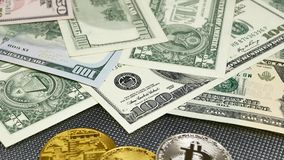 Golden and silver bitcoin coins and american dollars notes on abstract background. Bitcoin cryptocurrency. stock video