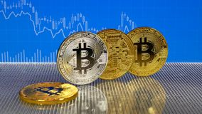Golden and silver bitcoin on blue abstract finance background. Bitcoin cryptocurrency. Golden and silver bitcoin on blue abstract finance background. Bitcoin stock footage