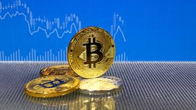 Golden and silver bitcoin on blue abstract finance background. Bitcoin cryptocurrency. stock video footage