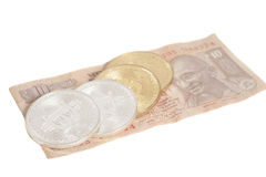 Golden and silver bitcoin coins on Indian Ten Rupee Royalty Free Stock Photo