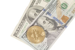 Golden and silver bitcoin coins and one hundred dollar banknote Stock Images