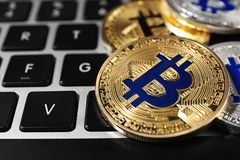 Golden and silver bitcoins on computer keyboard. Space for text. Golden and silver bitcoins on computer keyboard, closeup. Space for text royalty free stock photography