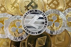 Golden and silver bitcoins, litecoins, etherum and ripple coins. royalty free stock photography
