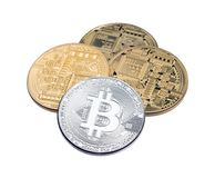 Golden and silver bitcoins on white background close up. royalty free stock images
