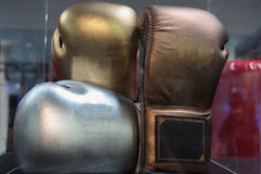 Golden, Silver and Bronze Leather Boxing Gloves Royalty Free Stock Photography