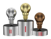 Golden, silver and bronze light bulbs on cylindrical pedestal. Front view Stock Photos