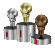 Golden, silver and bronze light bulbs on cylindrical pedestal Royalty Free Stock Image