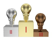 Golden, silver and bronze light bulbs on metallic pedestal. Front view Stock Photography