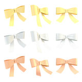 Golden, silver, bronze ribbon bows Royalty Free Stock Photo