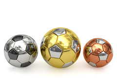 Golden, silver and bronze soccer balls on white. Background. High resolution 3D image rendered with soft shadows Royalty Free Stock Photo