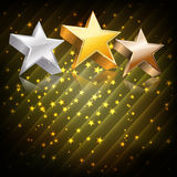 Golden, silver and bronze stars. On abstract dark background Stock Images