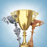 Golden,silver and bronze trophies Royalty Free Stock Photos