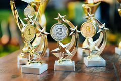 Golden, silver and bronze Trophy awards in a shape of a star and