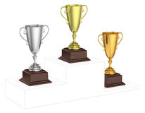 Golden, silver and bronze trophy cups on imaginary winners podiu Stock Images