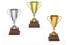 Golden, silver and bronze trophy cups on imaginary winners. Sports winning and championship and competition success concept - golden, silver and bronze winners Stock Photo