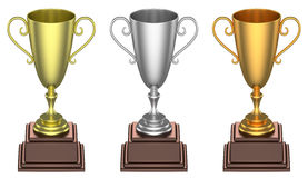 Golden, silver and bronze trophy cups isolated Stock Photography