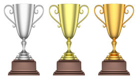 Golden, silver and bronze trophy cups isolated Stock Images