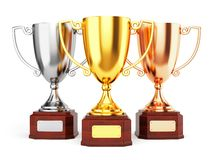 Golden, silver and bronze trophy cups. Isolated on white background. Three award goblet trophies Royalty Free Stock Photo