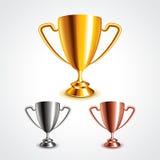 Golden, silver and bronze trophy cups vector set Stock Photos