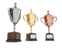 Golden, silver and bronze trophy cups on white background. 3D re. Nder Stock Image