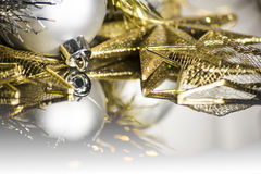 Golden and silver christmas balls and stars background. With reflection, focus and blurred Stock Image