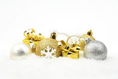 Golden,silver christmas decoration on snow Stock Image