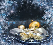 Golden and silver Christmas decorations. On dark abstract background. Shallow DOF, focus on the big ball Royalty Free Stock Images