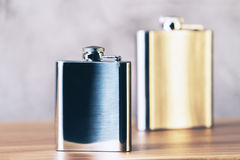 Golden and silver flask Royalty Free Stock Images