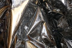 Golden, silver foil. Silver-golden foil as background for design and wallpaper stock image