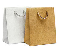 Golden and silver gift bags on white Stock Images