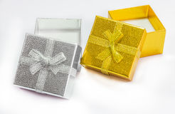 Golden and silver gift box with golden ribbon on white backgroun Royalty Free Stock Photo