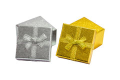 Golden and silver gift box with golden ribbon on white backgroun Royalty Free Stock Photography