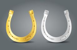 Golden and silver horseshoes Stock Photo