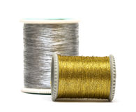 Golden and silver spools Stock Photos
