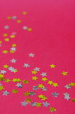 Golden and silver star confetti Stock Photos