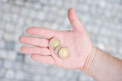Golden and silvery coins on hand Royalty Free Stock Images