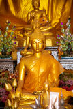 Golden sitting buddha Stock Photos