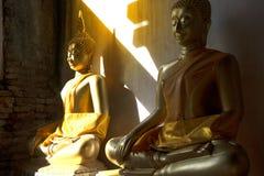 Golden sitting Buddha on cloister in Wat Phutthaisawan,Thailand. Stock Photo